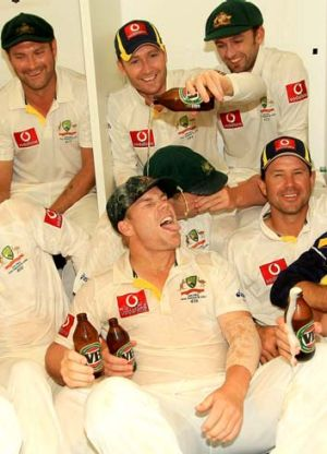 Michael Clarke pours a beer over David Warner.