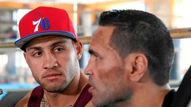 Donning the gloves: Blake Ferguson (L) with his cousin Anthony Mundine.
