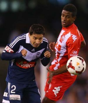 Pablo Contreras competes for the ball with Melbourne Heart's Golgol Mebrahtu during the A-League match between the teams ...