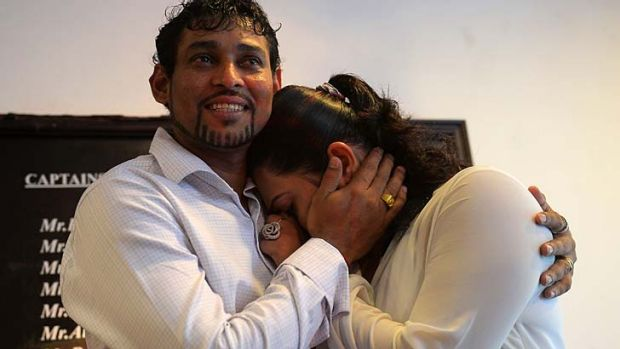 Tillakaratne Dilshan comforts his wife, Manjula Thilini, after she broke down when he announced his retirement from Test ...