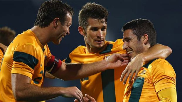 Matthew Leckie (right) of Australia celebrates with captain Lucas Neill after scoring.