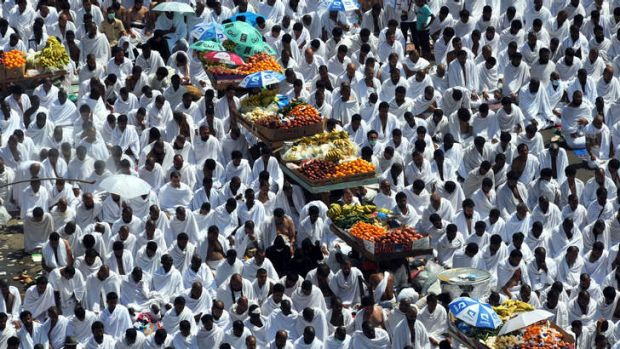 Fruit carts travel through pilgrims at the Namira mosque near Mount Arafat.