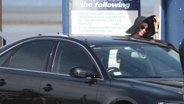 Angelina Jolie leaves a water taxi at Cleveland.