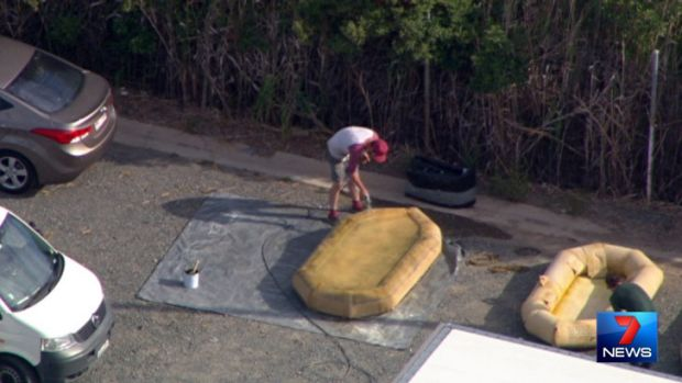 A production crew member inflates a liferaft on the set of Angelina Jolie's new movie. Photo: Seven News.