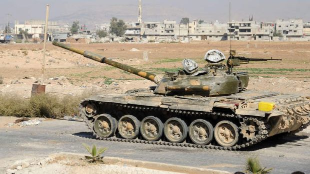 A tank in an empty street in the al-Bouydah district of the Syrian capital Damascus.
