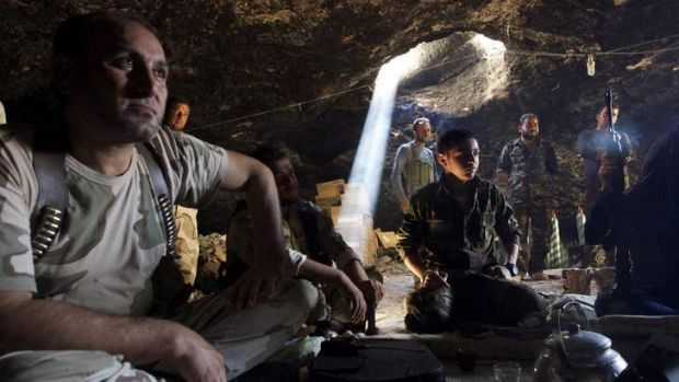 Free Syrian Army fighters gathered inside a cave in Maaret al-Naaman village, in Idlib.
