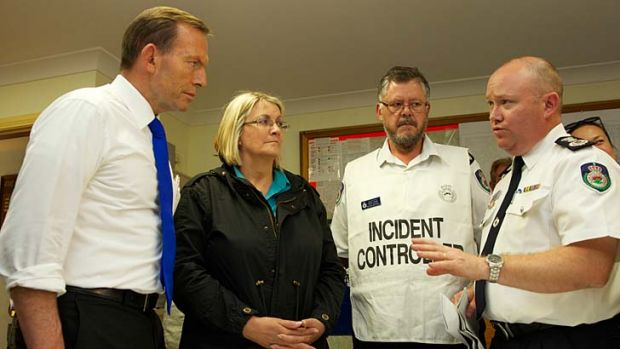 Fire front: Prime Minister Tony Abbott is briefed in the aftermath of the Winmalee bushfire.