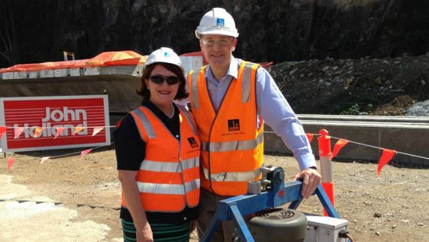Lord Mayor Graham Quirk and Councillor Vicki Howard inspect the first of 30 concrete girders for the new Riverwalk.