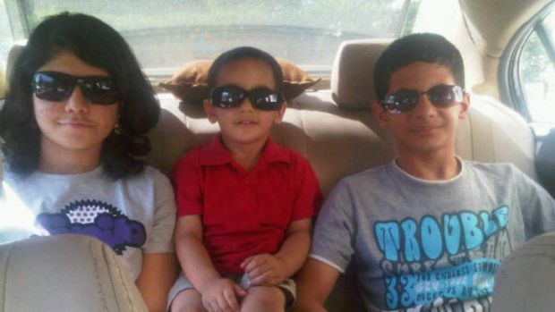 The Khan children (L to R): Romana, 17, Haider, 7, and Adam, 14.