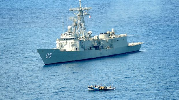 HMAS Melbourne approaches the Somali pirate vessel in the Indian Ocean.