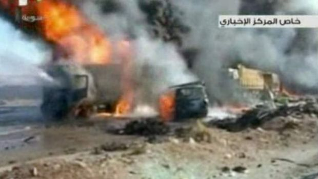 The aftermath of a truck bomb attack in Hama, Syria, which left as many as 30 people dead.