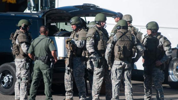 Swat team members secure the scene near Sparks Middle School in Sparks, Nevada, after a shooting there on Monday that ...