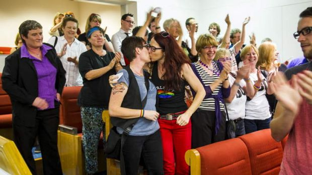 Julie Maynard and Frances Bodel, from Belconnen, celebrate in the public gallery after the same-sex bill is passed.