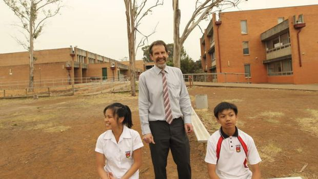 The principal Peter Ezzy of Plumpton High with students Christy Velasco who is in year 10 and her brother Joma who is in ...