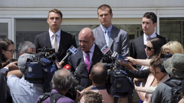 No jail time ... Lawyer Francis Cahill, centre front, addresses the media with Dylan Deblaquiere, left,  and Daniel ...