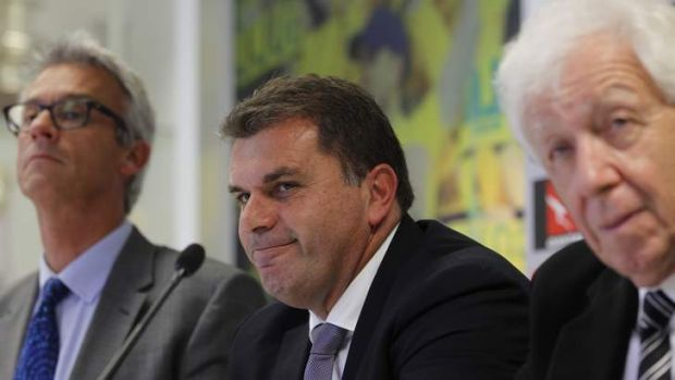 He's the man: New Socceroos coach Ange Postecoglou flanked by FFA CEO David Gallop and chairman Frank Lowy.