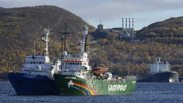 """Greenpeace ship """"Arctic Sunrise"""" is seen anchored outside the Arctic port city of Murmansk."""