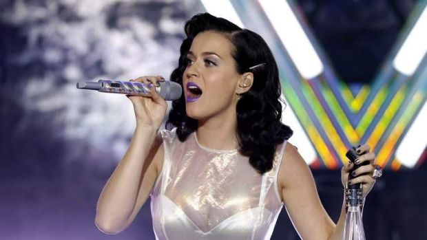 Uncomfortable: Katy Perry looked to her PR agent for help when a <i>Sunday Night</i> interview veered into topics deemed ...