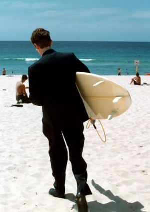 First rule of surfing and business: take off the suit before entering the water.