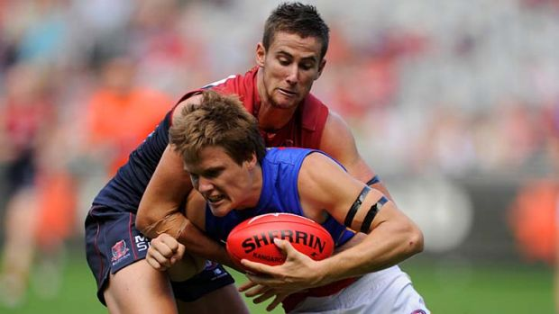 Former Brisbane Lion Jared Polec is tackled during the round one match against Melbourne.