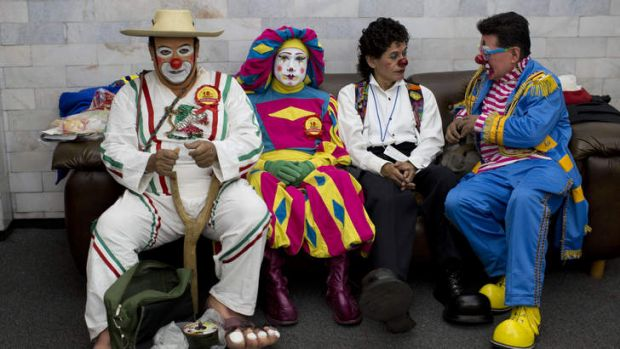 Clowns sit on a couch during a break on the first day of the 17th International Clown Convention in Mexico.