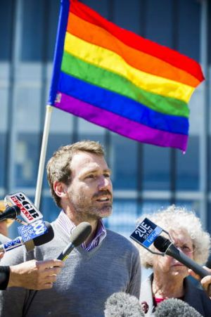 Deputy director of Marriage Equality Australia, Ivan Hinton, speaks to media outside the High Court of Australia after ...