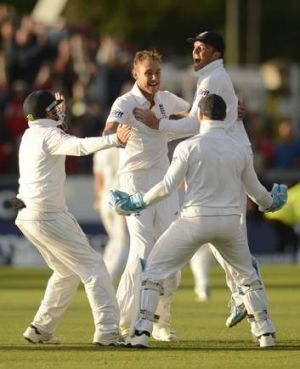 Stuart Broad is mobbed by teammates in Durham.