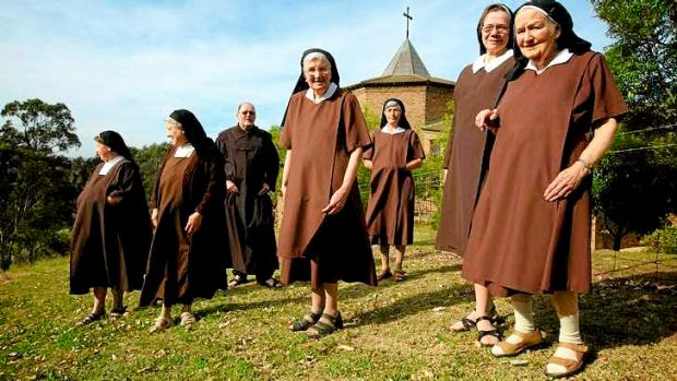 A formidable brown line: Discalced Carmelite nuns and Father Greg Burke at their Varroville monastery.