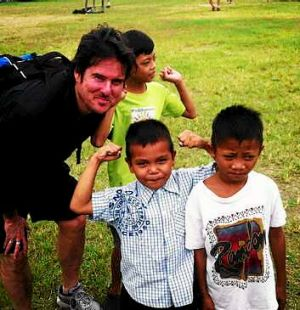Steve Mascord with children at an orphanage in Manila.