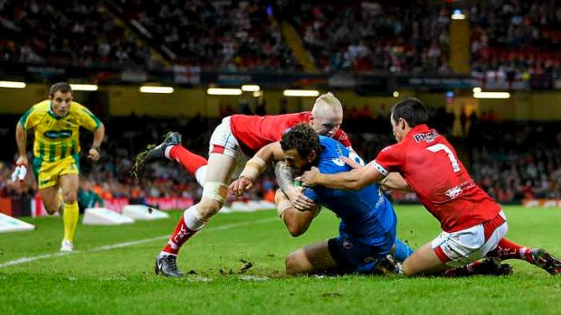Man of the match: Josh Mantellato of Italy crosses for a try