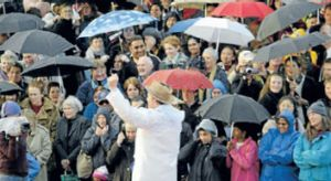 Citizens turn out to do some 'singin in the rain' at the festival's launch in 2003.