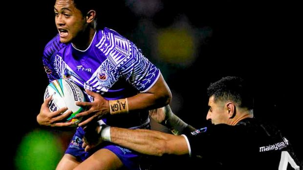 Attacking threat: Anthony Milford of Samoa.