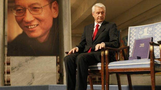 Norwegian Nobel Committee Chairman Thorbjoern Jagland sits next to empty chair during the ceremony to honour prize ...