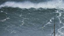 Surfer tackles monster wave off the coast of Portugal