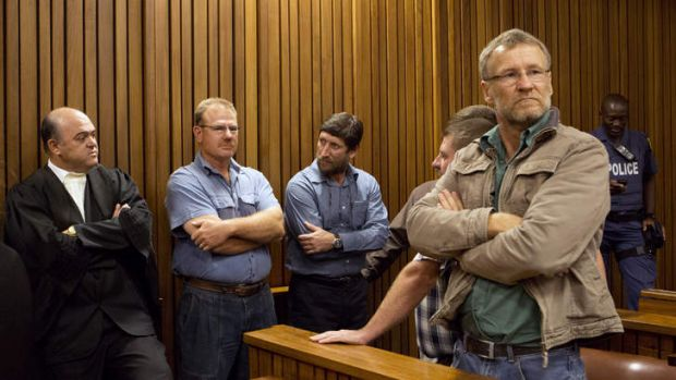 Some of the 20 right-wing extremists convicted of high treason for a plot to kill former South African President Nelson ...