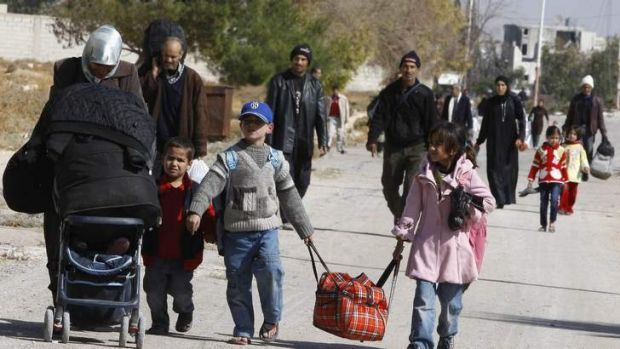 Some relief: Syrian families leave the Damascus suburb of Moadamiya during the ceasefire.