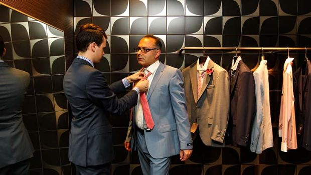 Fitting: Alex Kambos is measured for a Hugo Boss suit at DJs.