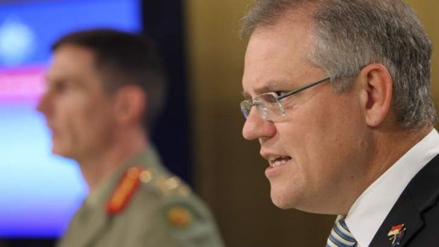 Immigration Minister Scott Morrison and Operation Sovereign Borders Commander, Lieutenant-General Angus Campbell, ...