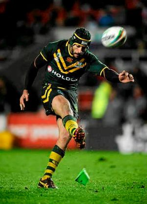 Man of the match Johnathan Thurston missed just one shot at goal despite the atrocious conditions.