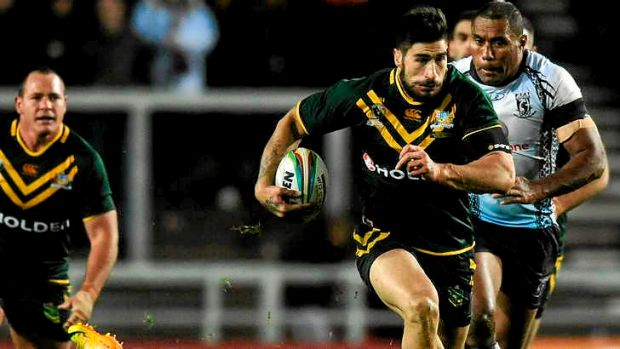 James Tamou of Australia busts open the Fijian defence in the lead up to Daly Cherry-Evans' try.