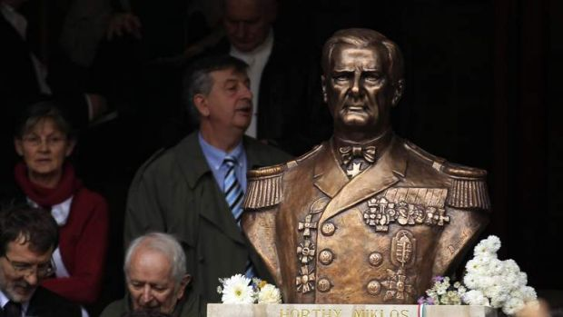 Right-wing nationalists attend a ceremony unveiling the statue of wartime leader Miklos Horthy in central Budapest.