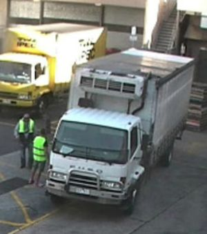 CCTV photos show two men in a white Mitsubishi Fuso truck collecting the televisions about 5pm on Friday afternoon.