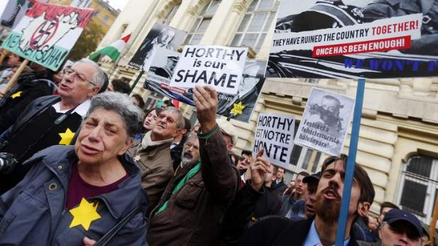 Hungarian opposition activists protest against the erection of a statue of wartime leader Miklos Horthy in central Budapest.