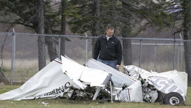 An FAA investigator examines the wreckage.