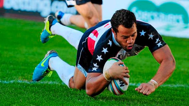 Stars and stripes: USA's Joseph Paulo dives over to score in the Tomahawks' upset defeat of hosts Wales at the Rugby ...