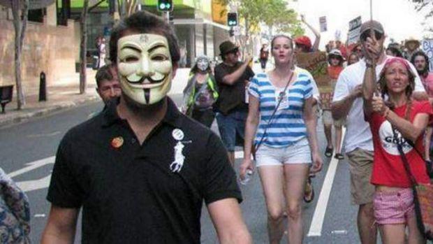 Daniel Walker marches in Brisbane's CBD.