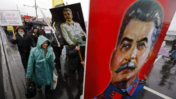 "People carry posters of late Soviet leader Joseph Stalin as they attend a ""Patriotic March"" demonstration, organized by ..."