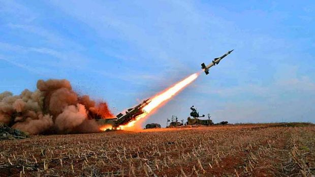 Weaponry is fired during a firepower strike drill of the Korean People's Army that Kim Jong-Un reportedly attended.