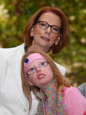 Former prime minister Julia Gillard meets Sophie Dean from the disabled community in May.