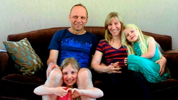 Marco de Vries and Rachel Sietzema and their children Rebecca, 7, and Shontai, 5.